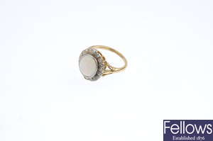 An early 20th century platinum and 18ct gold opal and diamond cluster ring.