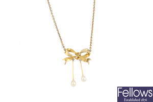 An early 20th century 15ct gold split and cultured pearl pendant, on chain.